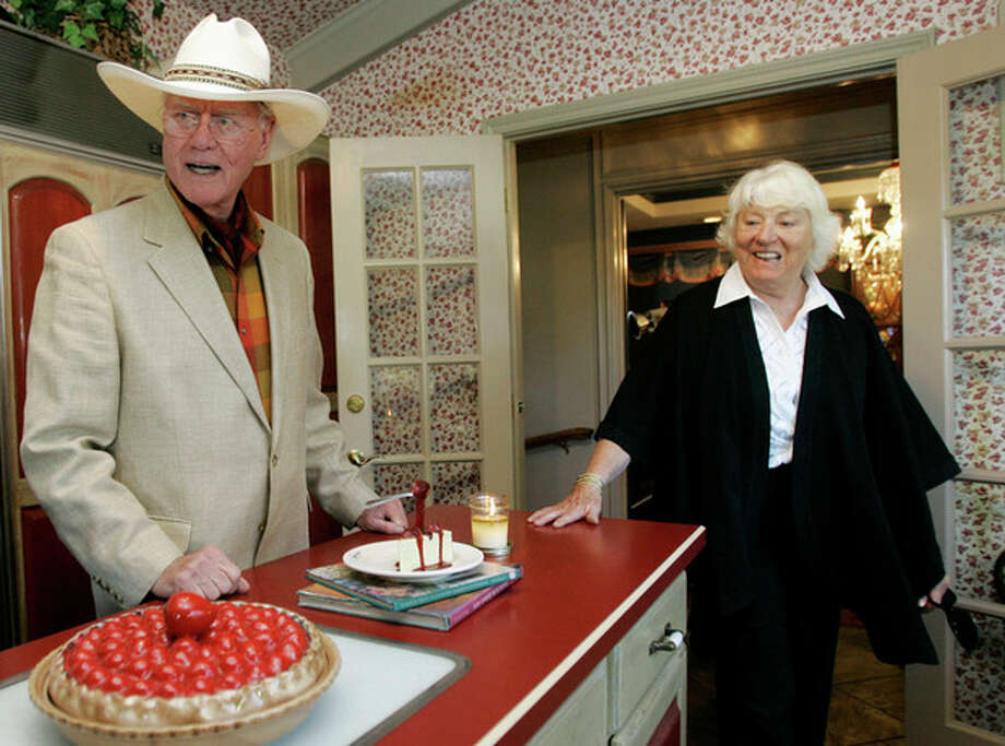 """FILE - In this Thursday, Oct. 9, 2008 file photo, actor Larry Hagman and his wife Maj, visit the kitchen area of the Southfork Ranch mansion in Parker, Texas made famous in the television show """"Dallas."""" Actor Larry Hagman, who for more than a decade played villainous patriarch JR Ewing in the TV soap Dallas, has died at the age of 81, his family said Saturday Nov. 24, 2012. (AP Photo/Tony Gutierrez, File) / AP"""