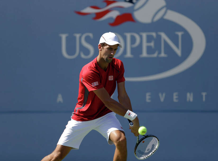 Serbia's Novak Djokovic practices a day before the US Open tennis tournament starts Sunday, Aug. 25, 2013, in New York. (AP Photo/Kathy Willens) / AP