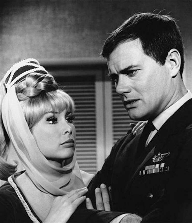 "FILE - This 1967 file photo shows Barbara Eden, left, and Larry Hagman in a scene from the television show ""I Dream of Jeannie."" Actor Larry Hagman, who for more than a decade played villainous patriarch JR Ewing in the TV soap Dallas, has died at the age of 81, his family said Saturday Nov. 24, 2012. (AP Photo/NBC, file) / NBC"