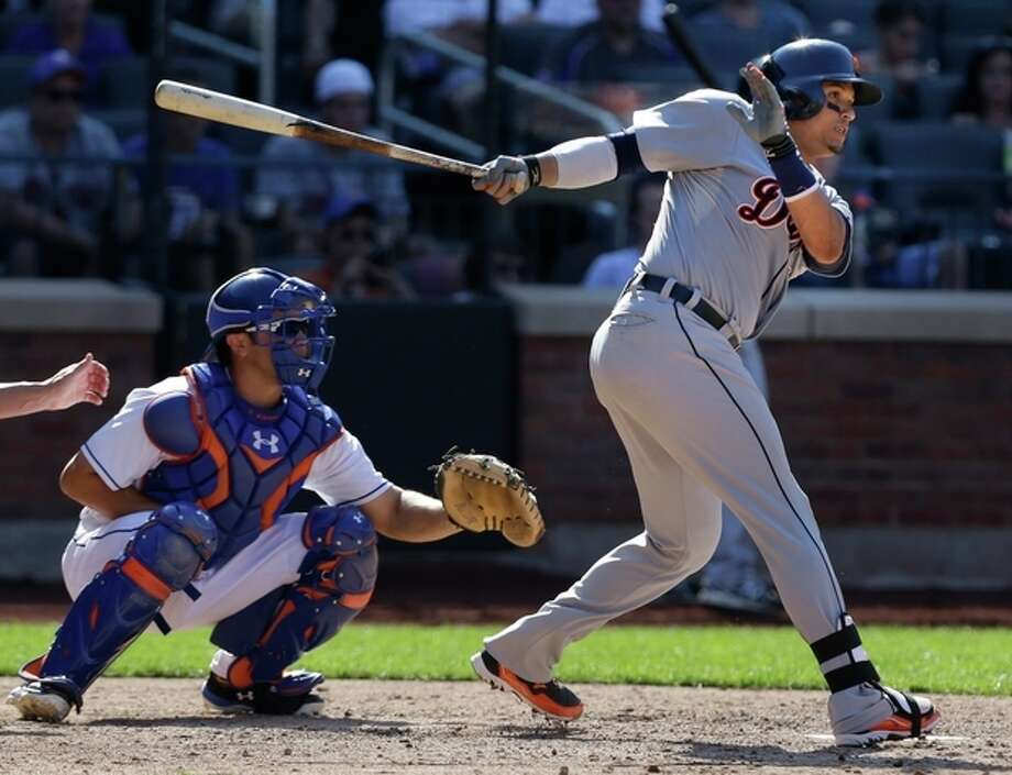 Detroit Tigers' Victor Martinez, right, hits an RBI-single during the ninth inning of an interleague baseball game against the New York Mets at Citi Field, Sunday, Aug. 25, 2013, in New York. The Tigers won 11-3. (AP Photo/Seth Wenig) / AP