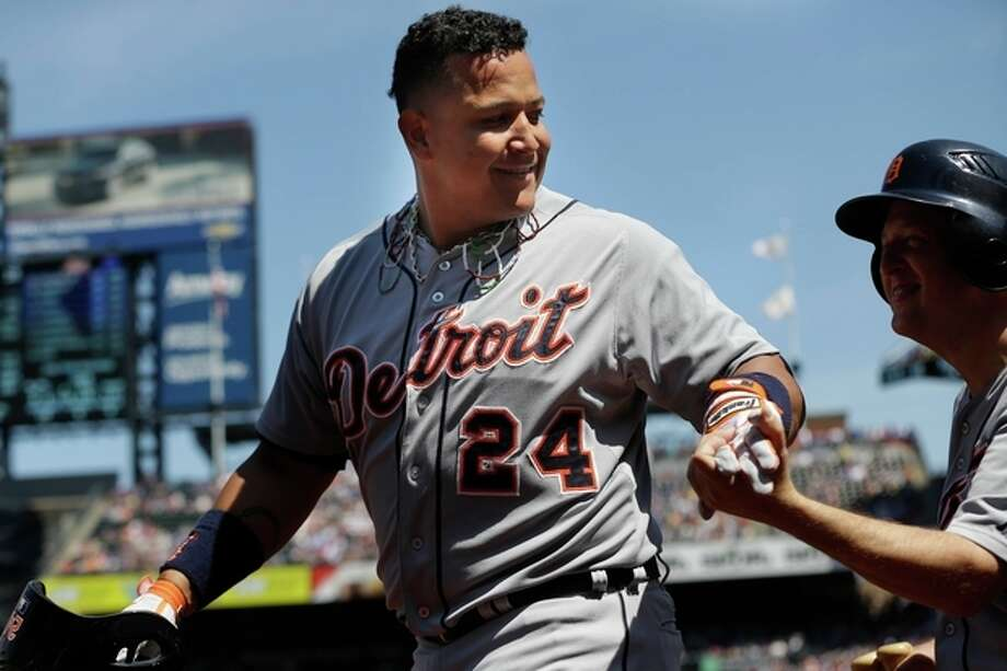 Detroit Tigers' Miguel Cabrera, left, celebrates his two-run home run with a bat boy during the first inning of an interleague baseball game against the New York Mets at Citi Field, Sunday, Aug. 25, 2013, in New York. (AP Photo/Seth Wenig) / AP