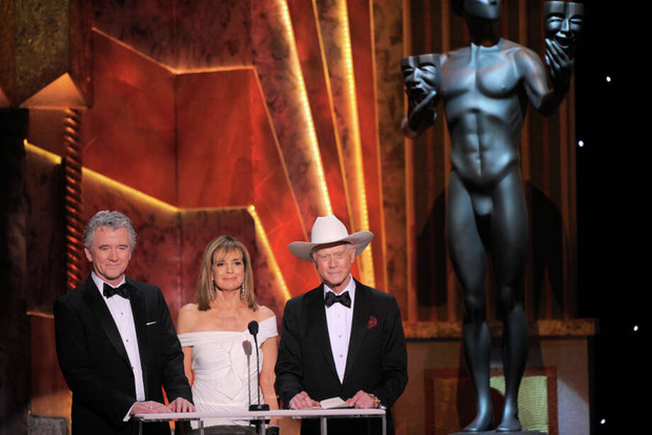 FILE - In this Sunday, Jan. 29, 2012 file photo, Patrick Duffy, left, Linda Gray, center, and Larry Hagman present the award for outstanding performance by an ensemble in a drama series at the 18th Annual Screen Actors Guild Awards in Los Angeles. Actor Larry Hagman, who for more than a decade played villainous patriarch JR Ewing in the TV soap Dallas, has died at the age of 81, his family said Saturday Nov. 24, 2012. (AP Photo/Mark J. Terrill, File) / AP