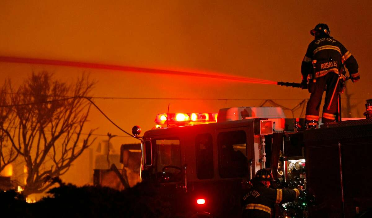 San Bruno, Daily city and San Francisaco Fire personal work to contain a fast moving fire caused by an explosion in a San Bruno nighborhood Thursday, Sept. 9, 2010.