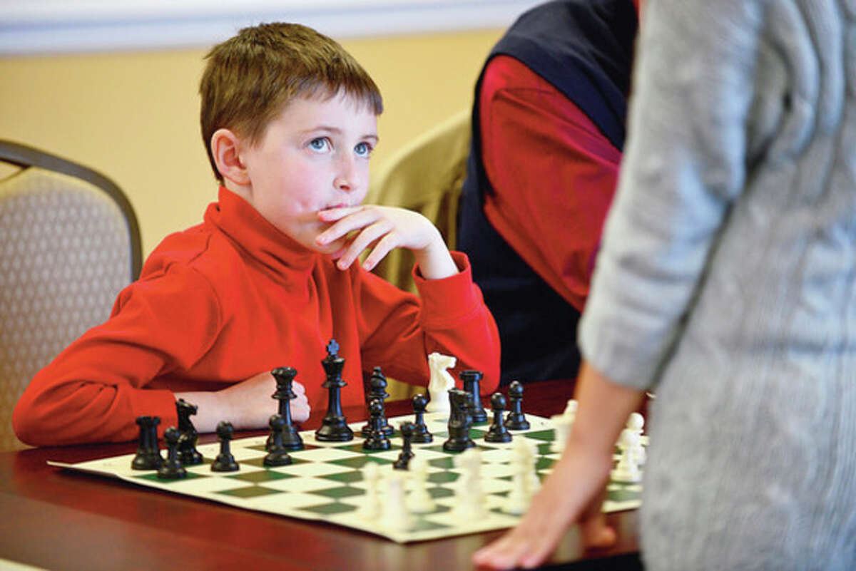 Hour photo / Erik Trautmann Women's International Chess Master Yuanling Yuan, the top Canadian Women's Player and Yale University freshman, challenges 20 other players, including 7-year- old Andrew Derwin, at the Chess Club of Fairfield County in Norwalk in simultaneous play Saturday.