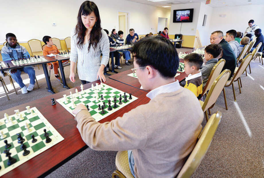 Hour photo / Erik TrautmannWomen's International Chess Master Yuanling Yuan, the top Canadian Women's Player and Yale University freshman, challenges 20 other players at the Chess Club of Fairfield County in Norwalk in simultaneous play Saturday. / (C)2012, The Hour Newspapers, all rights reserved