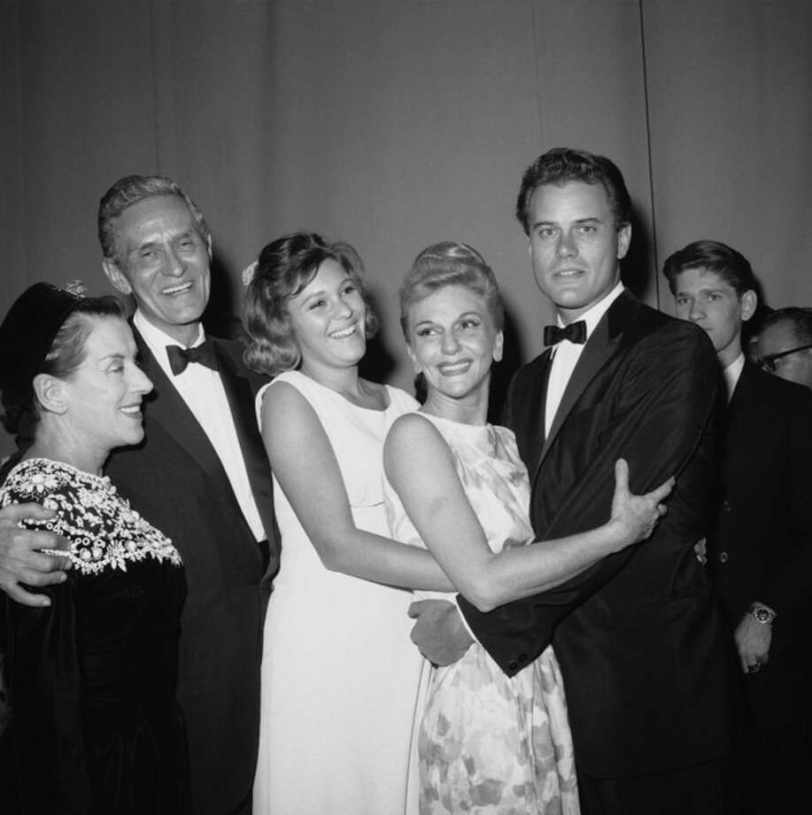 """FILE - In this Oct. 17, 1963 file photo, Broadway star Mary Martin is congratulated backstage after the opening of her new musical """"Jennie"""" at New York's Majestic Theater. From left are Beatrice Lillie Richard Halliday, husband of Mary Martin, Heller Weir, daughter of Mary Martin, and Martin's son Larry Hagman. Actor Larry Hagman, who for more than a decade played villainous patriarch JR Ewing in the TV soap Dallas, has died at the age of 81, his family said Saturday Nov. 24, 2012. (AP Photo/Ray Howard, File) / AP"""