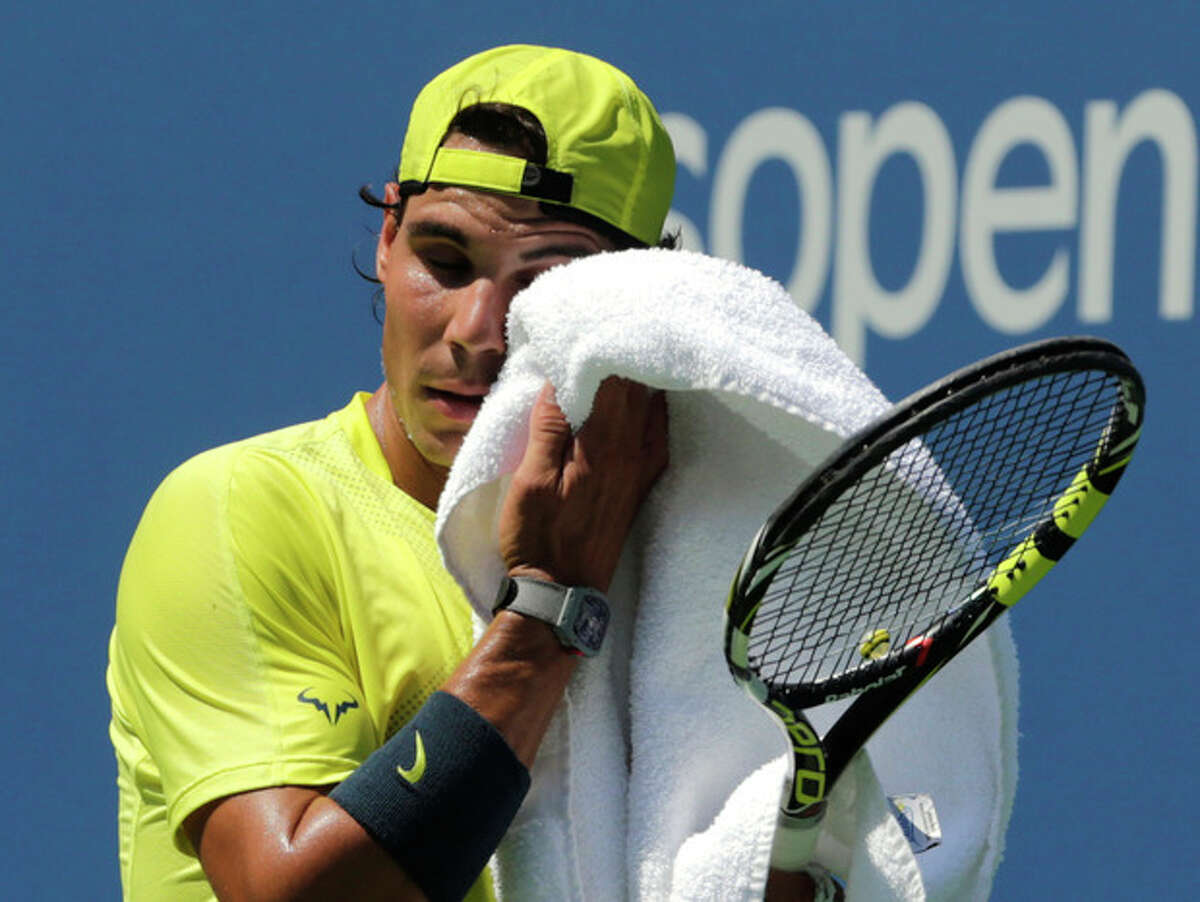 Spain's Rafael Nadal wipes his face during practice a day before the US Open tennis tournament, Sunday, Aug. 25, 2013, in New York. (AP Photo/Charles Krupa)