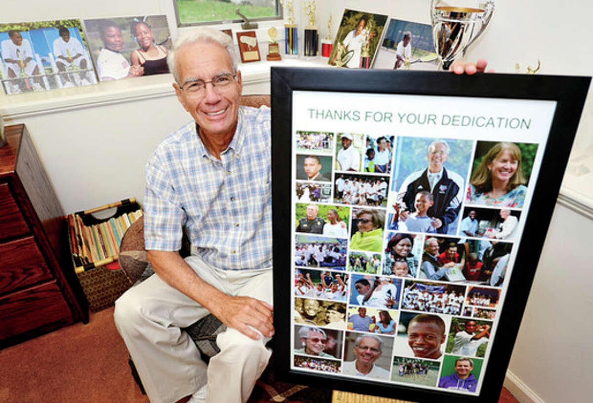 Hour photo / Erik Trautmann Art Goldblatt, founder of the Norwalk Grassroots Tennis program, shows off some of his prized possessions from his time involved in the program.