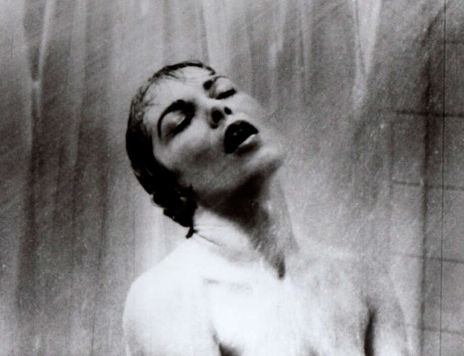 """FILE - In this 1960 file photo, actress Janet Leigh appears as Marion Crane in the shower scene in Alfred Hitchcock's 1960 classic thriller """"Psycho."""" Hitchcock's """"Psycho"""" is a film that 52 years after its shocking premiere still hasn't released audiences from its subversive thrall. The film, which Hitchcock called """"a fun picture,"""" was revolutionary in its violence, its sexiness, its sympathy to the perspective of the criminal mind, and, perhaps above all, its technique. (AP Photo/File) / AP"""