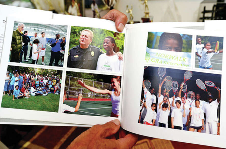Hour photo/Erik TrautmannArt Goldblatt, founder of the Norwalk Grass Roots Tennis program, shows off some of his memories from 18 years of the program. / (C)2013, The Hour Newspapers, all rights reserved