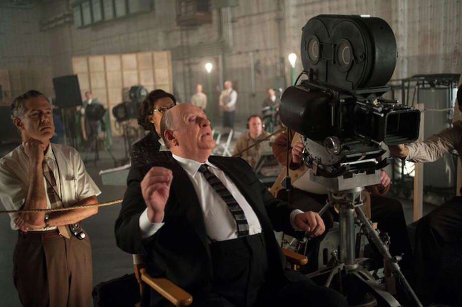 """This publicity film image released by Fox Searchlight shows Anthony Hopkins as Alfred Hitchcock in """"Hitchcock."""" The new film """"Hitchcock,"""" which is set during the making of the """"Psycho,"""" is only the latest expression of never-ending obsession of Hitchcock's most influential masterpiece. (AP Photo/Fox Searchlight, Suzanne Tenner, File) / Fox Searchlight Pictures"""