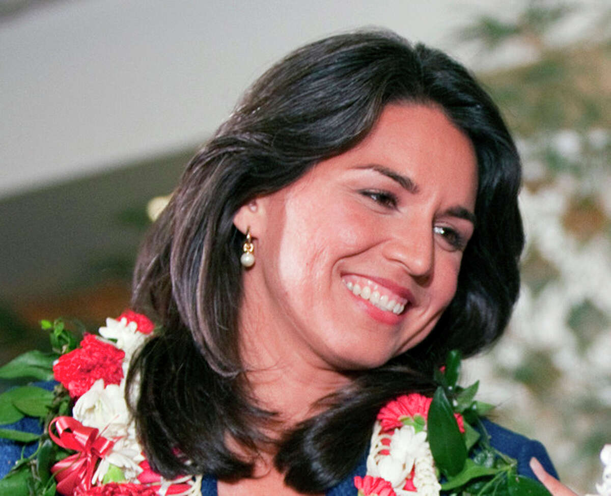 FILE This Nov. 6, 2012 file photo shows Iraq war veterans Rep.-elect Tulsi Gabbard in Honolulu. Veterans groups say the influx of Iraq and Afghanistan veterans in Congress is welcome because it comes at a time when the overall number of veterans in Congress is on a steep and steady decline. In the mid-1970s, the vast majority of lawmakers tended to be veterans. (AP Photo/Marco Garcia, File)