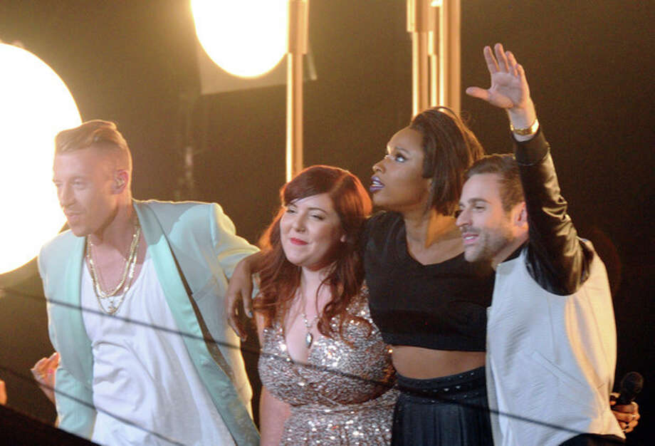 Macklemore, from left, Mary Lambert, Jennifer Hudson and Ryan Lewis perform at the MTV Video Music Awards on Sunday, Aug. 25, 2013, at the Barclays Center in the Brooklyn borough of New York. (Photo by Charles Sykes/Invision/AP) / Invision