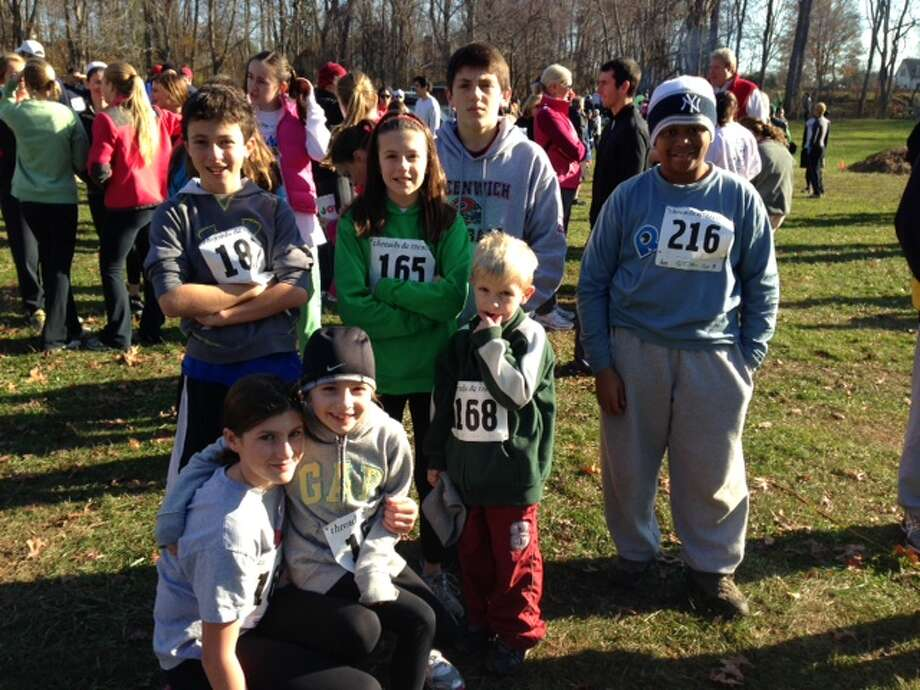 The Marinaccio children pose with their Fresh Air sibling Dante before the Backcountry Bushwhack race.