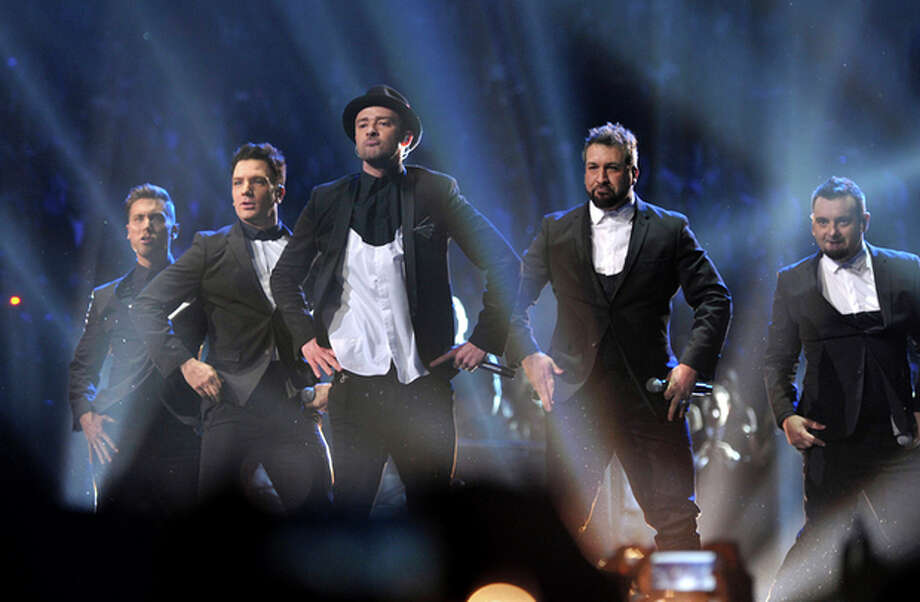 This image released by MTV shows, from left, Lance Bass, JC Chasez, Justin Timberlake, Joey Fatone and Chris Kirkpatrick, of 'N Sync, at the MTV Video Music Awards at Barclays Center on Sunday, Aug. 25, 2013, in the Brooklyn borough of New York. (AP Photo/ MTV, John Shearer) / MTV