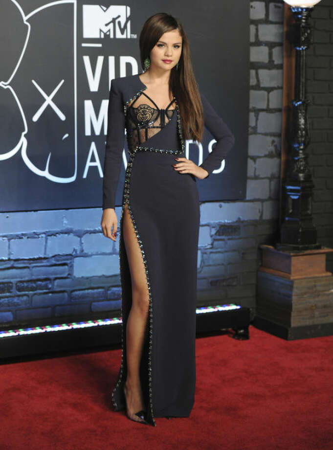Selena Gomez arrives at the MTV Video Music Awards on Sunday, Aug. 25, 2013, at the Barclays Center in the Brooklyn borough of New York. (Photo by Evan Agostini/Invision/AP)