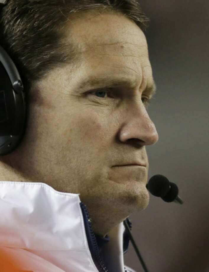 Auburn coach Gene Chizik watches the game near the end of a 49-0 loss to Alabama during the second half of a NCAA college football game at Bryant-Denny Stadium in Tuscaloosa, Ala., Saturday, Nov. 24, 2012. (AP Photo/Dave Martin)