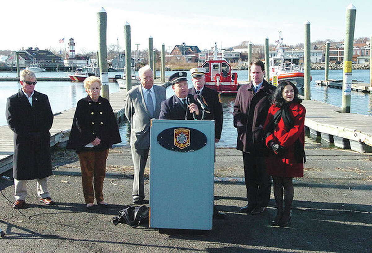 Hour Photo Alex von Kleydorff; Lt. Timoty Morrissette speaks to the crowd as the Fire Departments new fire boat is commissioned at Veterans Memorial Park in Norwalk Monday
