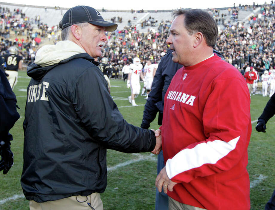 Purdue head coach Danny Hope, left, meets with Indiana head coach Kevin Wilson following an NCAA college football game in West Lafayette, Ind., Saturday, Nov. 24, 2012. Purdue defeated Indiana 56-35. (AP Photo/Michael Conroy) / AP