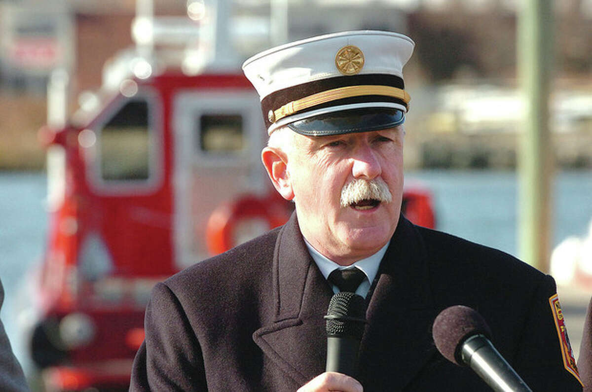 Hour Photo Alex von Kleydorff; Norwalk Fire Chief Denis McCarthy speaks to the crowd as the Fire Departments new fire boat is commissioned at Veterans Memorial Park in Norwalk Monday