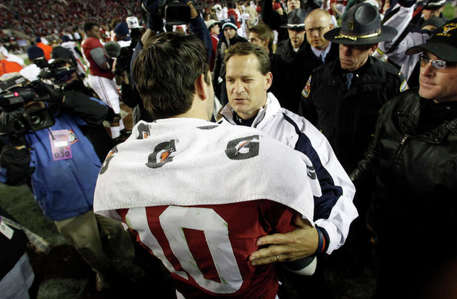 Auburn coach Gene Chizik congratulates Alabama quarterback AJ McCarron (10)following a NCAA college football game at Bryant-Denny Stadium in Tuscaloosa, Ala., Saturday, Nov. 24, 2012. Alabama beat Auburn 49-0. (AP Photo/Butch Dill) / FR111446 AP