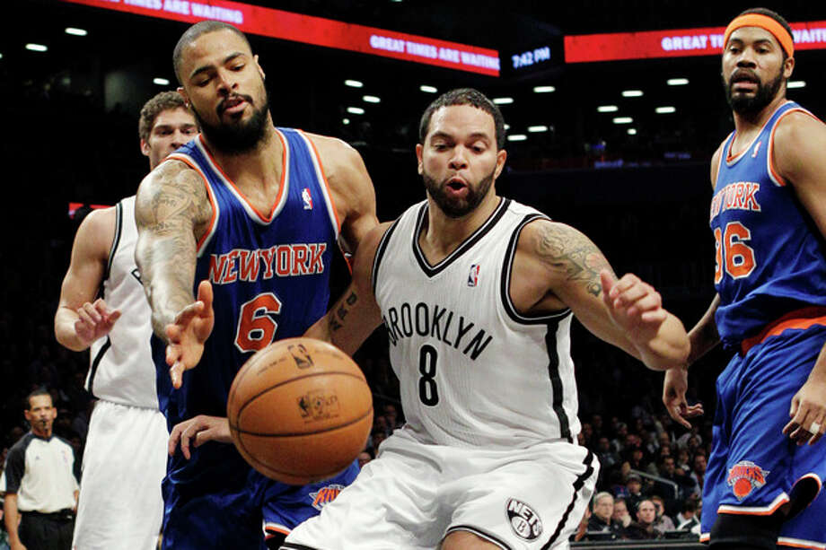 New York Knicks center Tyson Chandler (6) knocks the ball from the hands of Brooklyn Nets guard Deron Williams (8) in the first half of their NBA basketball game at Barclays Center, Monday, Nov. 26, 2012, in New York. Nets' Brook Lopez, rear left, and Knicks' Rasheed Wallace (36) watch the play. (AP Photo/Kathy Willens) / AP