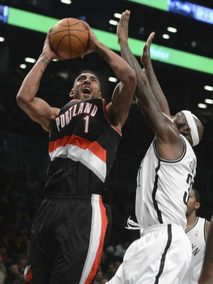 Portland Trail Blazers' Jared Jeffries, left, is fouled by Brooklyn Nets' Reggie Evans in the third quarter of the NBA basketball game at the Barclays Center, Sunday, Nov. 25, 2012, in New York. The Nets won 98-85. (AP Photo/Henny Ray Abrams)