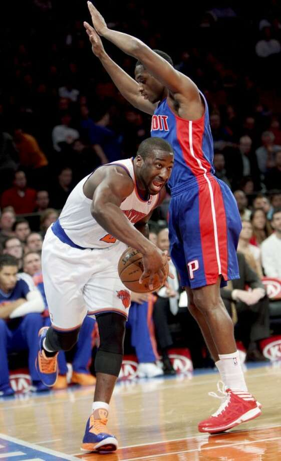 New York Knicks' Raymond Felton, left, drives past Detroit Pistons' Brandon Knight during the first half of an NBA basketball game in New York, Sunday, Nov. 25, 2012. (AP Photo/Seth Wenig)