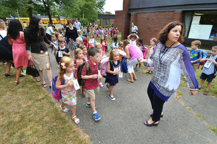 Hour Photo/Alex von Kleydorff. Teacher Erica Jacobs leads a group of students to their first day of School at Miller Driscoll in Wilton