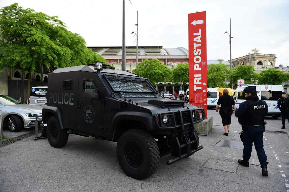 Police vans and an armored vehicle are parked outside the Euralille shopping mall in Lille, France on June 14. Police increased security for the UEFA Euro football tournament. Photo: LEON NEAL, Stringer / AFP or licensors