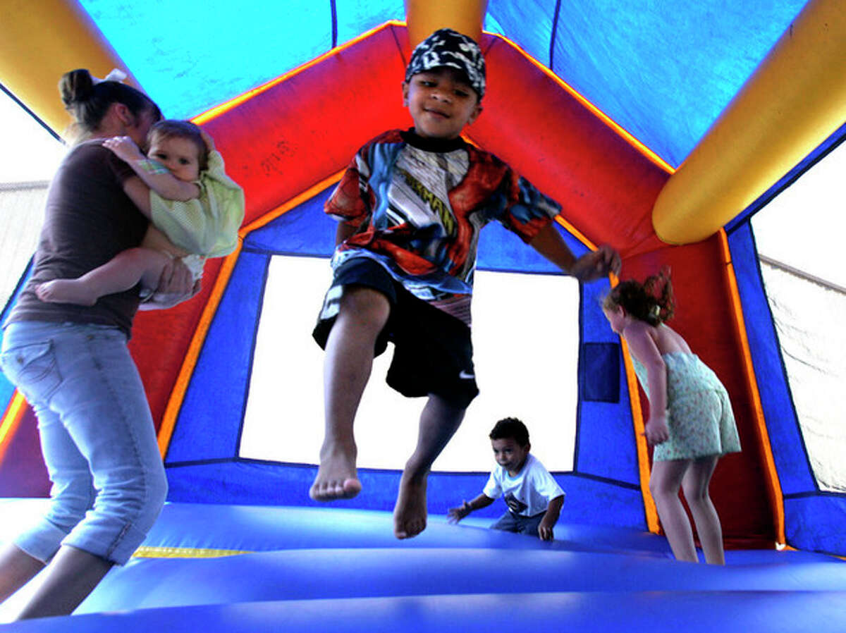 FILE - In this Sept. 11, 2005 file photo, children play in a bounce house in Vidor, Texas. A nationwide study released Monday, Nov. 26, 2012, found inflatable bounce houses can be dangerous and the number of kids injured in related accidents has soared 15-fold in recent years. The numbers suggest 30 U.S. children a day are treated in emergency rooms for broken bones, sprains, cuts and concussions from bounce house accidents. (AP Photo/LM Otero, File)