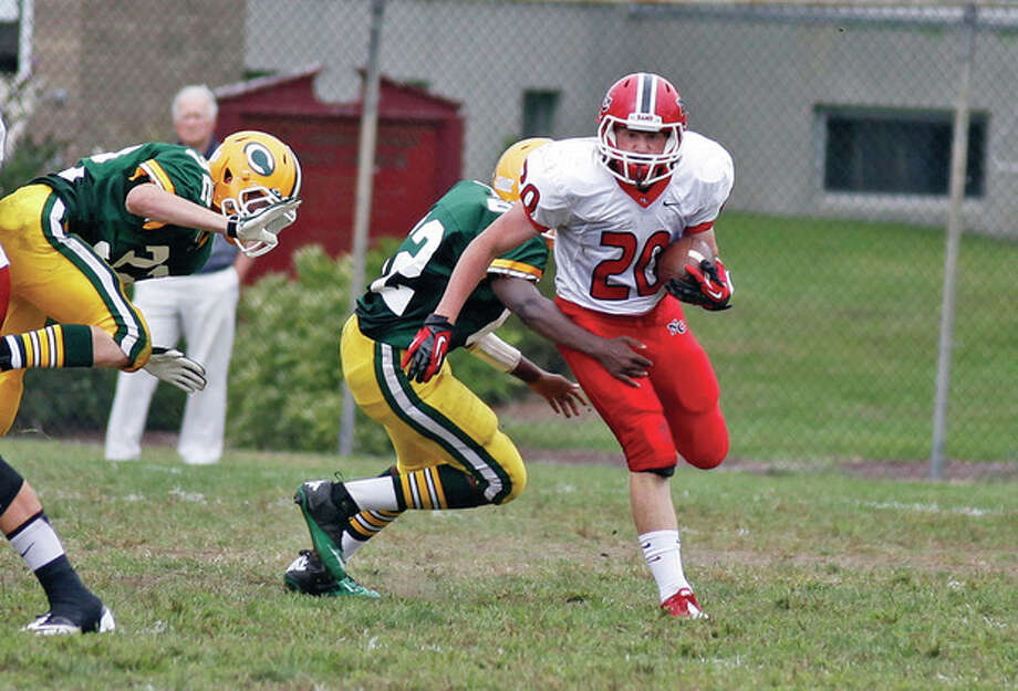 New Canaan's #20, Andrew Read, runs with ball during an away game at Trinity Catholic in Stamford Saturday afternoon.Hour Photo / Danielle Robinson