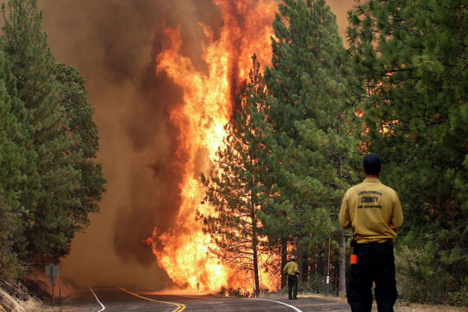AP Photo/Jae C. HongThe Rim Fire burns along Highway 120 near Yosemite National Park, Calif., on Sunday, Aug. 25. With winds gusting to 50 mph on Sierra mountain ridges and flames jumping from treetop to treetop, hundreds of firefighters have been deployed to protect this and other communities in the path of the Rim Fire raging north of Yosemite National Park. / AP