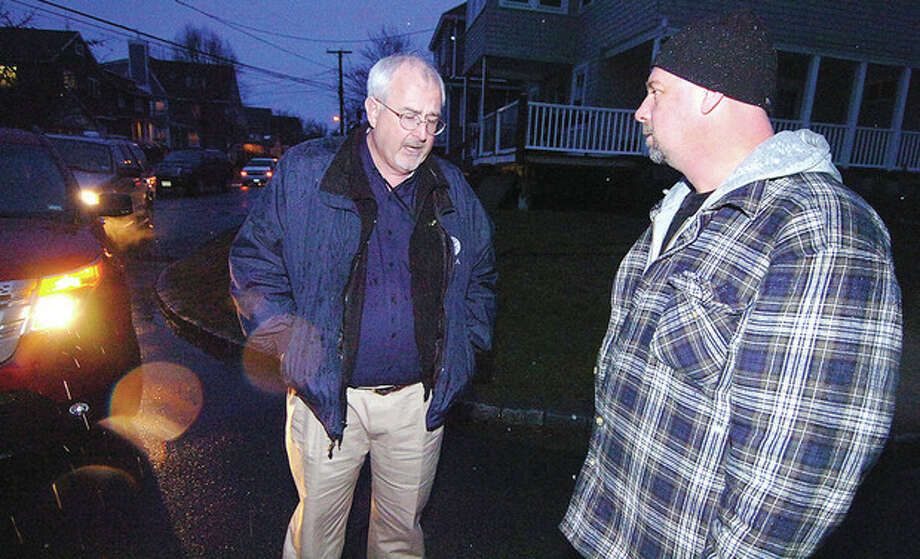 Hour photo / Alex von KleydorffFEMA Administrator Craig Fugate speaks with Harborside home owner Michael Harden during a tour of the hard hit neighborhood Tuesday. / 2012 The Hour Newspapers