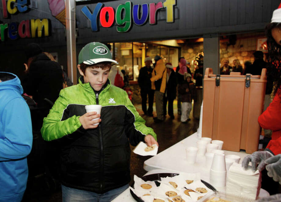 Brien McMahon, 10, grabs some hot chocolate and a cookie during Stew Leonard's annual tree lighting Tuesday evening.Hour Photo / Danielle Robinson