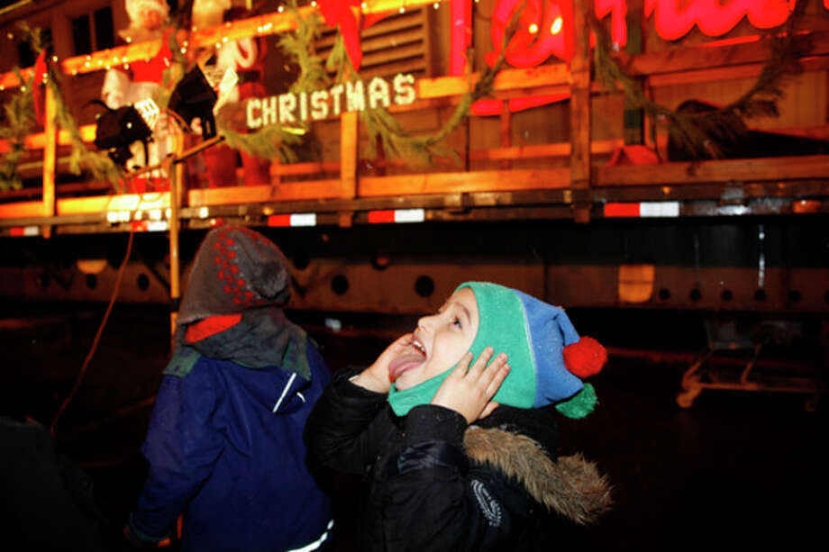 Kostantinos Koloustos, 5, trys to catch a snowflake during Stew Leonard's annual tree lighting Tuesday evening.Hour Photo / Danielle Robinson