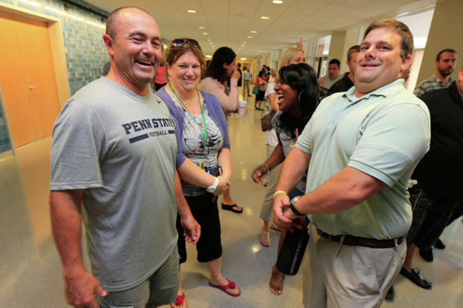West Rocks Middle School teachers Pat Testa and Kevin Lippert chat before the teachers convocation Monday monrning at Brien McMahon. Hour Photo / Chris Palermo / © 2013 Hour Newspapers All Rights Reserved