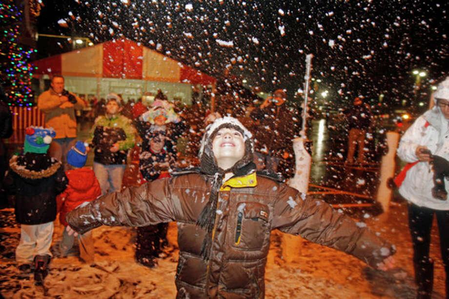 Dimitrios Koloustos, 8, plays in the snow during Stew Leonard's annual tree lighting Tuesday evening.Hour Photo / Danielle Robinson