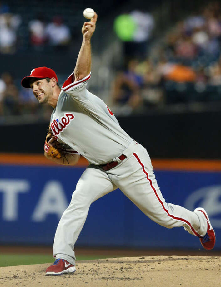 Philadelphia Phillies starting pitcher Cliff Lee (33) throws in the first inning of a baseball game against the New York Mets at Citi Field, Monday, Aug. 26, 2013, in New York. (AP Photo/Paul J. Bereswill)