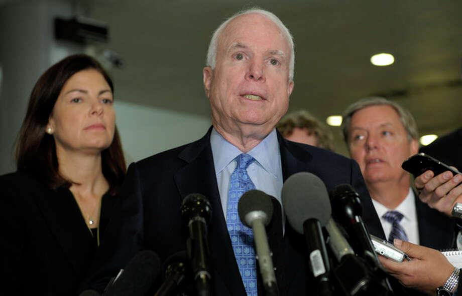 Sen. John McCain, R-Ariz., ranking Republican on the Senate Armed Services Committee, center, flanked by fellow committee members, Sen. Kelly Ayotte, R-N.H., left, and Sen. Lindsey Graham, R-S.C., right, speaks on Capitol Hill in Washington, Tuesday, Nov. 27, 2012, following a meeting with UN Ambassador Susan Rice. Rice met with lawmakers to discuss statements she made about the attack on the U.S. Consulate in Libya that left the ambassador and three other Americans dead. (AP Photo/Susan Walsh) / AP