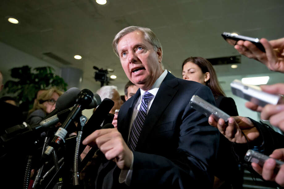 Sen. Lindsey Graham, R-S.C., a member of the Senate Armed Services Committee and the Senate Homeland Security Committee, center, accompanied by fellow Senate Armed Services Committee member, Sen. Kelly Ayotte, R-N.H.,, right, gestures while speaking to reporters on Capitol Hill in Washington, Tuesday, Nov. 27, 2012, after a closed-door meeting with UN Ambassador Susan Rice. (AP Photo/J. Scott Applewhite) / AP