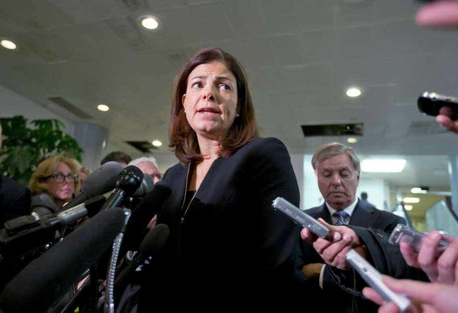 Senate Armed Services Committee member, Sen. Kelly Ayotte, R-N.H.,, center, accompanied by fellow Senate Armed Services Committee member, Sen. Lindsey Graham, R-S.C., right, speaks to reporters on Capitol Hill in Washington, Tuesday, Nov. 27, 2012, following a closed-door meeting with UN Ambassador Susan Rice. (AP Photo/J. Scott Applewhite) / AP