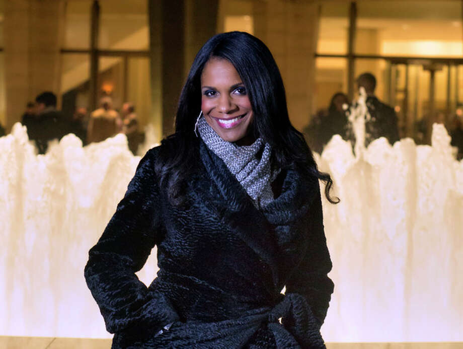 """In this photo provided by """"Live from Lincoln Center,"""" Broadway star Audra McDonald poses for a portrait in front of the Lincoln Center in New York. PBS said Tuesday, Nov. 27, 2012, that the singer-actress is the new host of """"Live from Lincoln Center."""" McDonald will emcee seven broadcasts from December through spring 2013, starting Dec. 13 with """"The Richard Tucker Opera Gala."""" (AP Photo/""""Live from Lincoln Center,"""" Chase Newhart) / Live from Lincoln Center"""