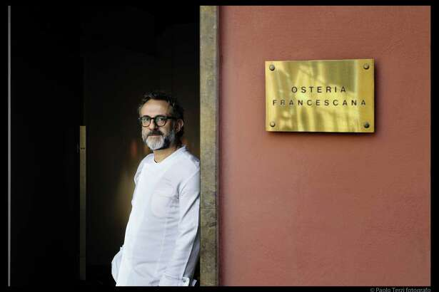 """In this handout picture released by the """"Osteria Francescana"""" on June 14, 2016, Italian Chef Massimo Bottura poses at the entrance of his restaurant. Italy's """"Osteria Francescana"""" , run by Massiomo Bottura was crowned world's best restaurant of 2016 at an awards ceremony in New York on June 13, 2016, the first Italian establishment to win the annual accolade. / AFP PHOTO / Osteria Francescana / paolo terzi / RESTRICTED TO EDITORIAL USE - MANDATORY CREDIT """"AFP PHOTO / OSTERIA FRANCESCANA / PAOLO TERZI"""" - NO MARKETING NO ADVERTISING CAMPAIGNS - DISTRIBUTED AS A SERVICE TO CLIENTS == NO ARCHIVE PAOLO TERZI/AFP/Getty Images"""