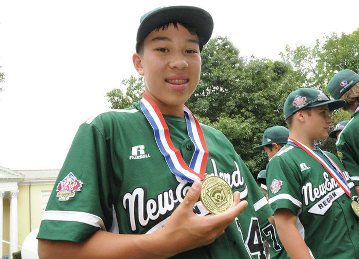 Westport Little League pitcher Chad Knight with his medal from the New England Reginals recognizing Westport as a World Series participant on the teams float on Monday. Hour photo/Matthew Vinci
