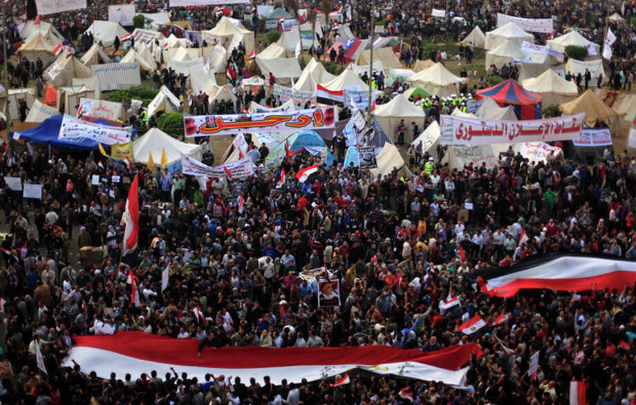 Egyptian protesters attend an opposition rally in Tahrir Square in Cairo, Egypt, Tuesday, Nov. 27, 2012. Thousands flocked to Cairo's central Tahrir square on Tuesday for a protest against Egypt's president in a significant test of whether the opposition can rally the street behind it in a confrontation aimed at forcing the Islamist leader to rescind decrees that granted him near absolute powers.(AP Photo/Khalil Hamra) / AP