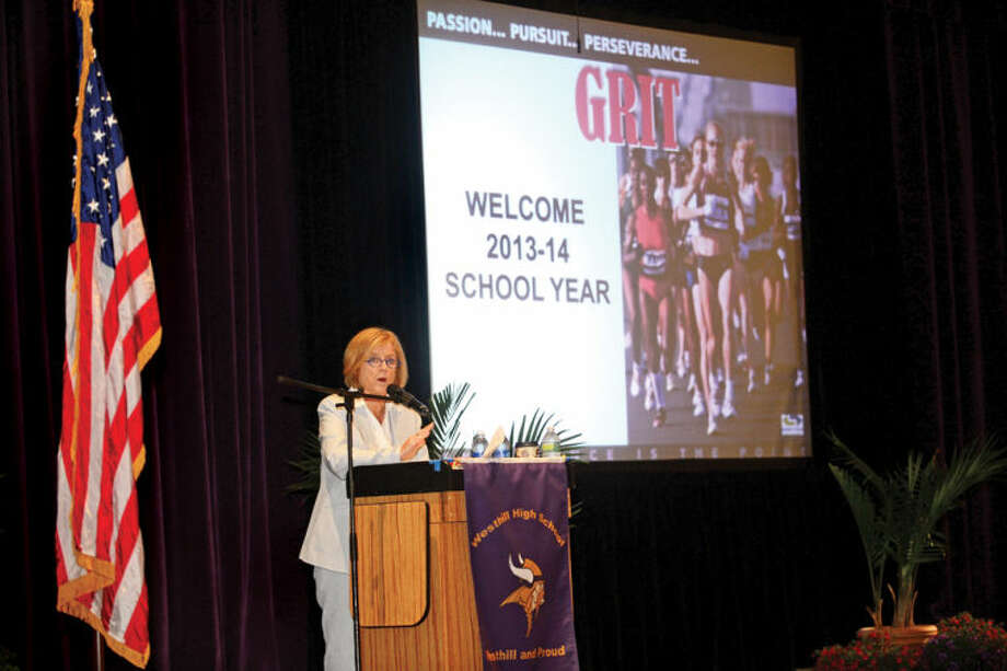 """SuperintendentWinifred Hamilton sets the theme of """"grit"""" for the 2013-14 school year during the staff convocation at Westhill High School Wednesday morning."""