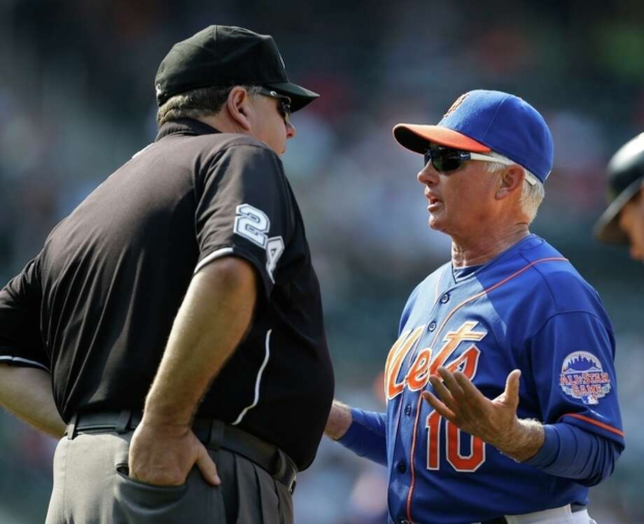 New York Mets manger Terry Collins, right, argues with umpire Jerry Layne over a call during the tenth inning of the baseball game against the Atlanta Braves at Citi Field, Wednesday, Aug. 21, 2013, in New York. Collins was later ejected and the Braves won 4-1. (AP Photo/Seth Wenig) / AP