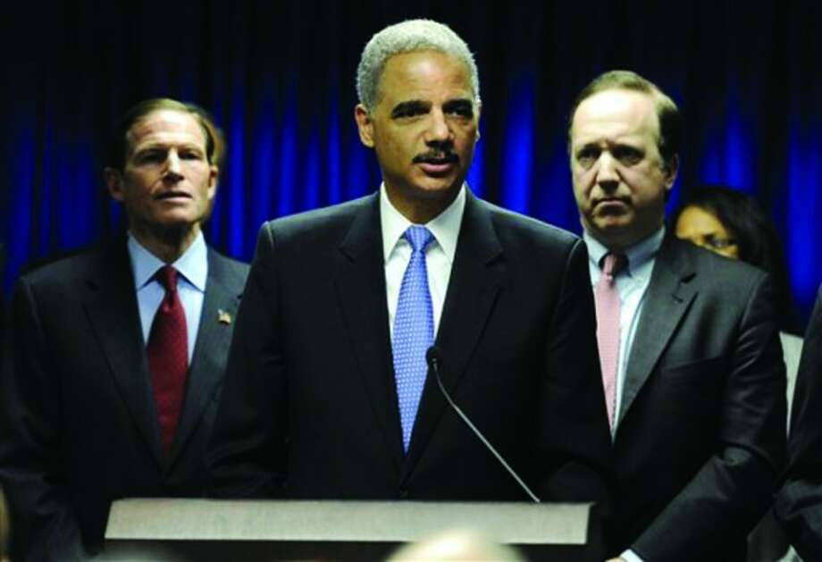 U.S. Attorney General Eric Holder, center speaks at a news conference to announce a new effort to reduce gun violence in the state's major cities, as U.S. Sen. Richard Blumenthal, D-Conn., left, and U.S. Attorney David Fein, right, look on, in New Haven, Conn., Tuesday, Nov. 27, 2012. (AP Photo/Jessica Hill)