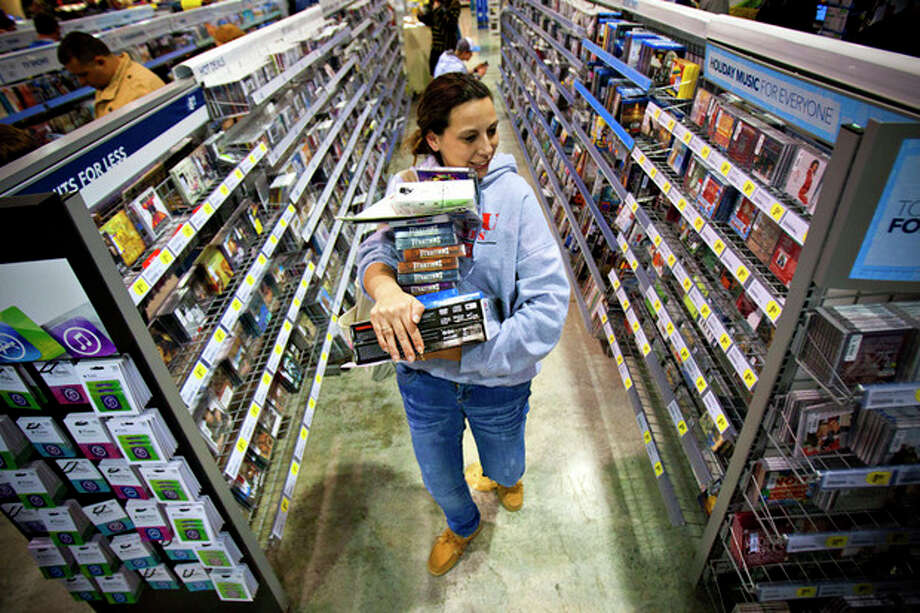 FILE -In this Friday, Nov. 23, 2012, file photo, Tonya Thomas, of Russellville, Ky., makes her way through the aisles at Best Buy in Bowling Green, Ky. U.S. consumer confidence rose this month to its highest level in almost five years, helped by a better outlook for hiring over the next six months. The Conference Board said Tuesday, Nov. 27, 2012, that its consumer confidence index rose to 73.7 in November from 73.1 in October. Both are the best readings since February 2008. (AP Photo/Daily News, Alex Slitz) / Daily News